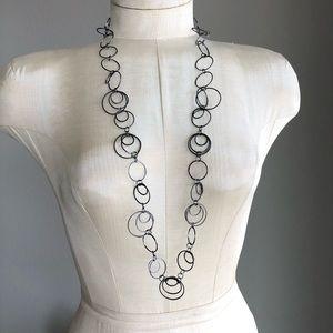 Gunmetal tone circles long necklace